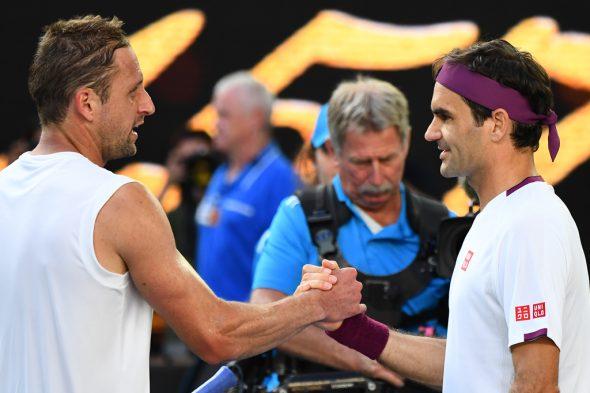 Tennys Sandgren und Roger Federer (Bild: William West/AFP)